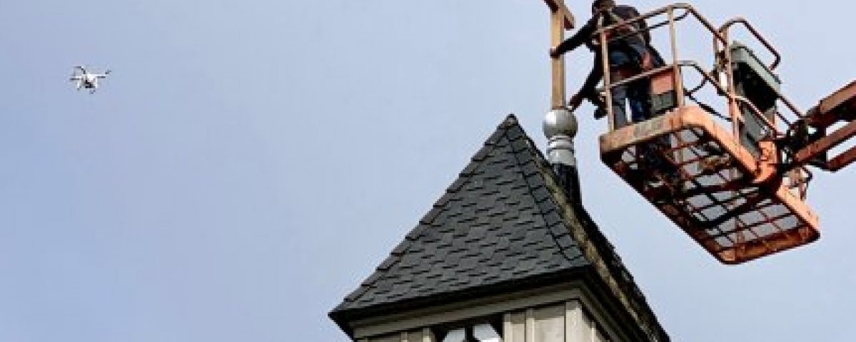 Today's service will be a celebration of Holy Cross Day, in honor of the newly made and installed cross on top of the church's steeple.